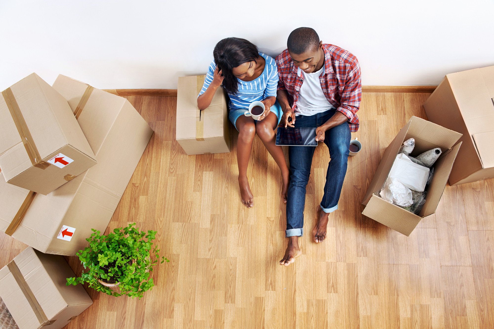 Couple with moving boxes in new apartment