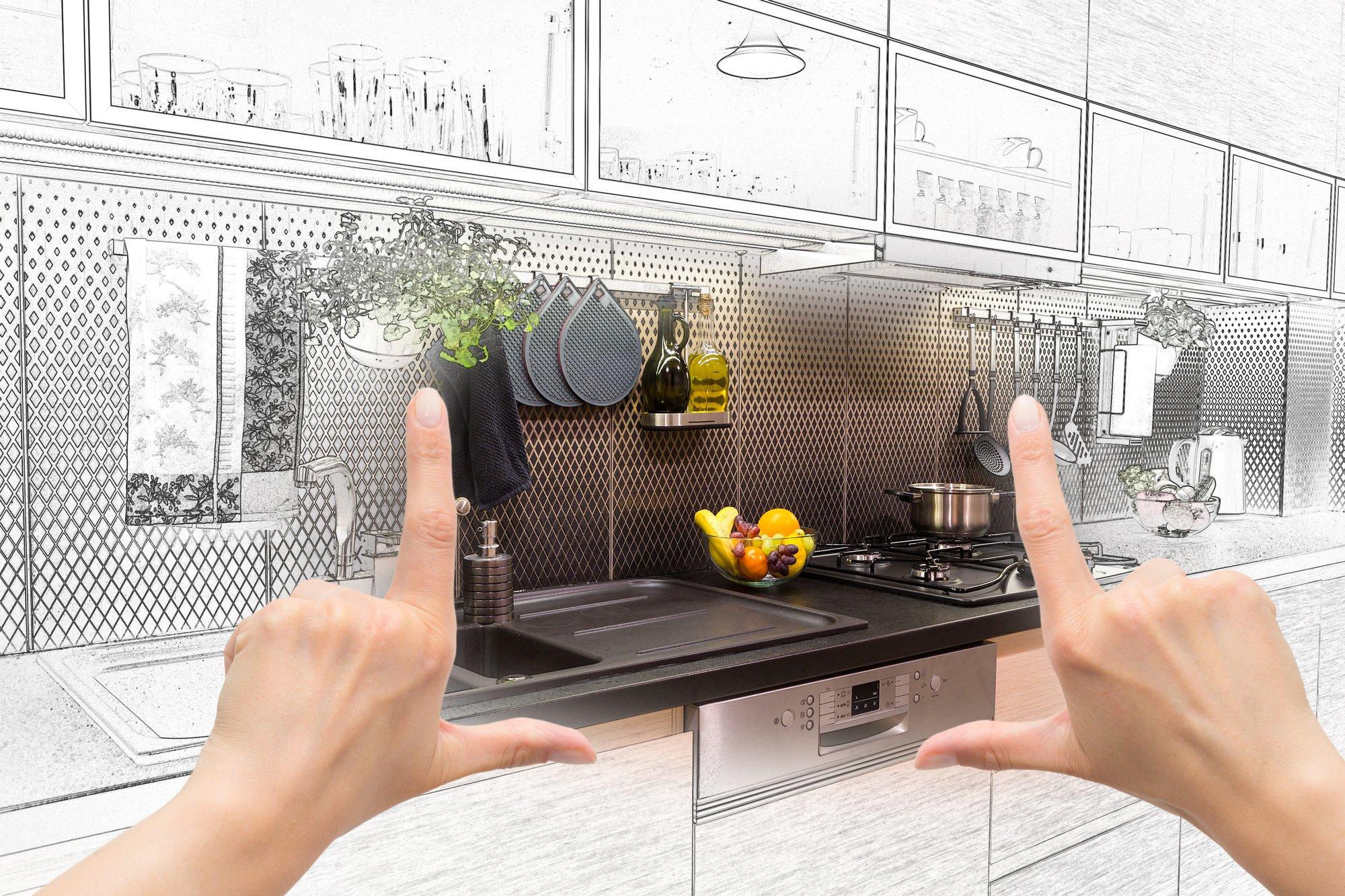Female hands framing custom kitchen design