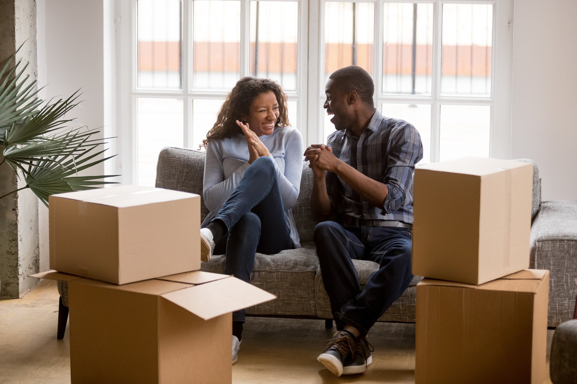 Happy african american couple feeling excited on moving day