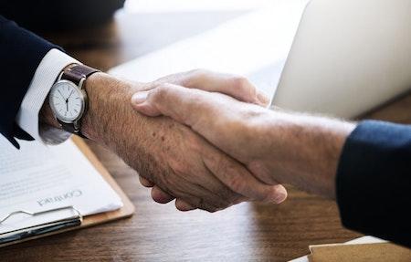 hand-shake-hands-watch-desk