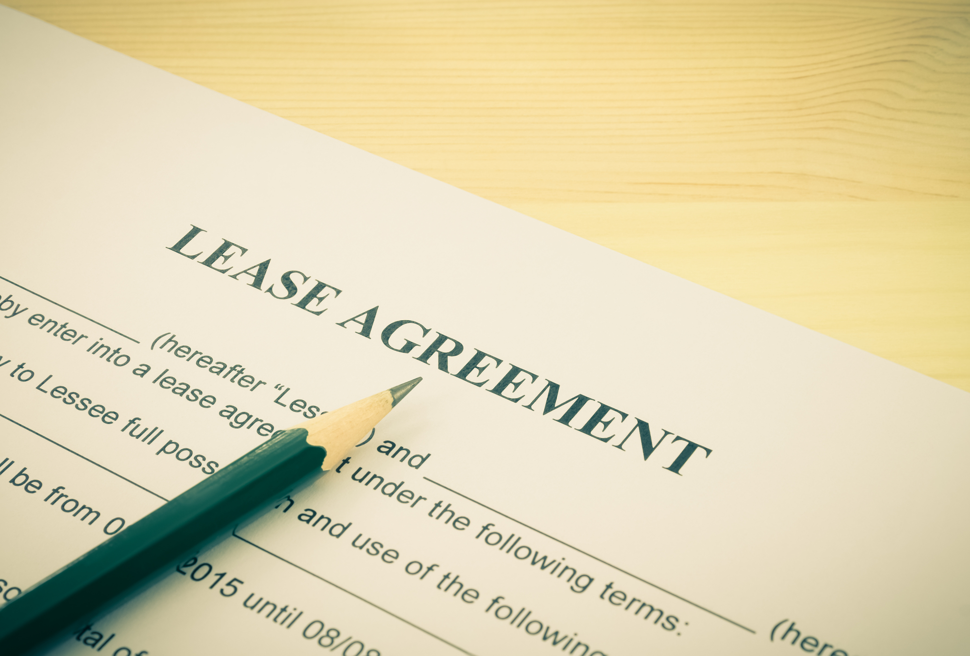 Lease Agreement Contract Document and Pencil