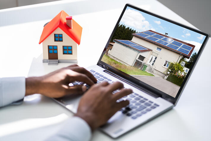 Looking Real Estate Home Or House On Laptop Computer