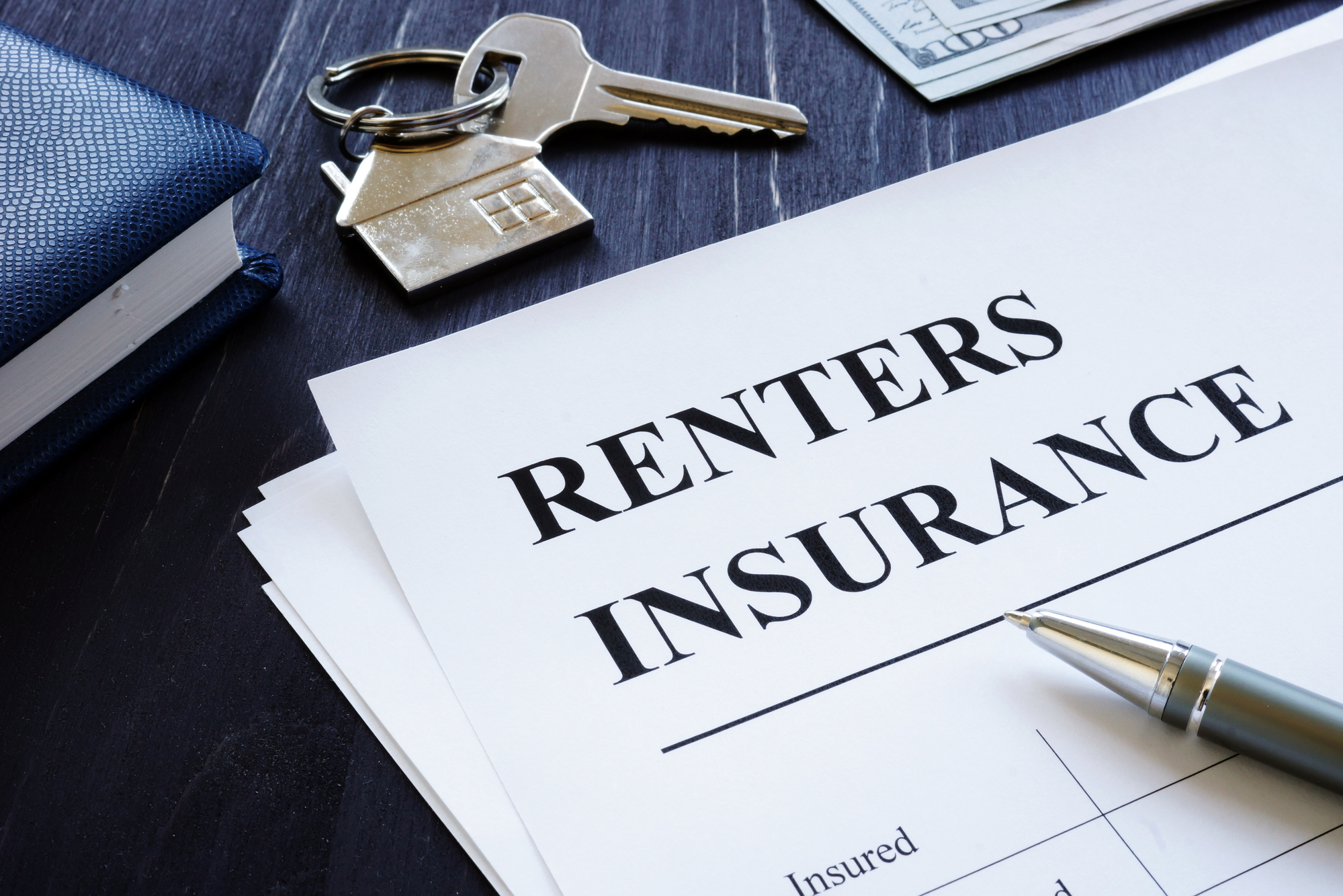 Renters Insurance policy agreement and key from apartments